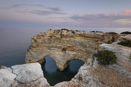 Algarve, Portugal. Nature celebrates Valentines Day. Amazing seascape of romantic scenario. Heart-shaped Rock in Marinha Beach on the southern coast of Portugal