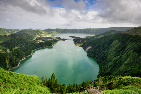 Panoramic landscape from Azores lagoons. The Azores archipelago has volcanic origin and the island of SÃ £ o Miguel has many lakes formed in craters of ancient volcanoes. One of the main tourist destinations in Portugal and much desired for family holidays.