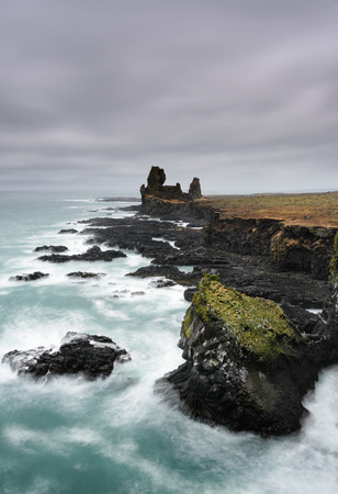 Northern cost of Iceland. Amazing Icelandic landscape at Londrangar Cliffs. Beautiful seascape in Iceland. Travel picture.