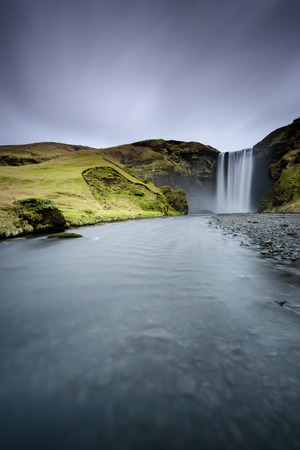 Beautiful Skogafoss. Amazing landscape at sunset in the most popular waterfall in Iceland. Long exposure effect. Dawn in the ring road.