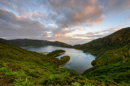 Panoramic landscape from Azores lagoons. The Azores archipelago has volcanic origin and the island of S? ? o Miguel has many lakes formed in craters of ancient volcanoes. One of the main tourist destinations in Portugal and much desired for family holidays.