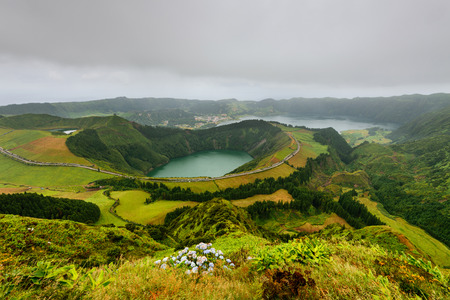 Panoramic landscape from Azores lagoons. The Azores archipelago has volcanic origin and the island of Sao Miguel has many lakes fand is the best travel destination of Portugal.