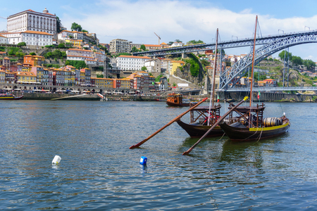Typical boats of the Douro River in Oporto. Panoramic views of the historic city center of Porto in Portugal. Landscape at famous travel destination.