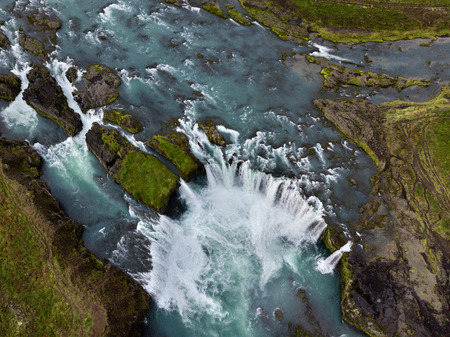 Skyview of Godafoss (Go?afoss) waterfall. It is one of the spectacular waterfalls in Iceland. Skj?lfandaflj?t River. Aerial photography captured by drone. 版權商用圖片