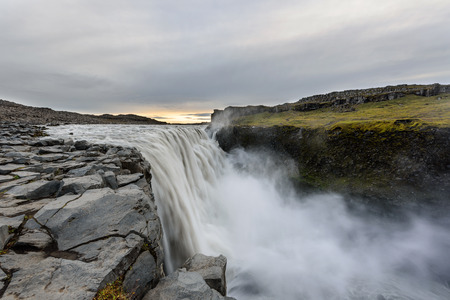Dettifoss is a waterfall in Vatnajokull National Park in Iceland, and is the most powerful waterfall in Europe. Amazing landscape at sunrise.