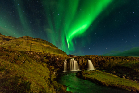 The Northern Light at the mountain Kirkjufell Iceland. Amazing landscape with green bands of Aurora Borealis. Snaefellnes, Iceland 版權商用圖片