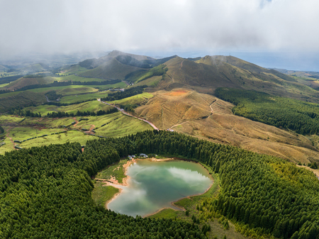 Drone view of Canario Lagoon. Lake formed by the crater of an old volcano in San Miguel island, Azores, Portugal. Bird eye view, aerial panoramic view.