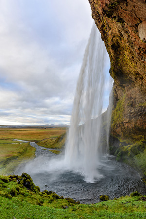 Majestic Seljalandsfoss; the most famous waterfall in Iceland. Sunset landscape. Beautiful tourist attraction in one of the main holiday destinations. 版權商用圖片