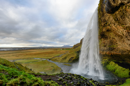 Majestic Seljalandsfoss, the most famous waterfall in Iceland. Sunset landscape. Beautiful tourist attraction in one of the main holiday destinations. 版權商用圖片