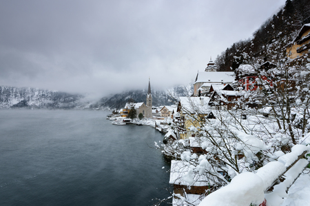 The Christmas village of Hallstatt in the Austrian Alps, in winter time covered with snow. Scenic postcard view of famous Hallstatt lakeside town in Austria.