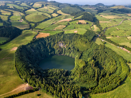 Drone view of amazing lagoon. Lake formed by the crater of an old volcano in San Miguel island, Azores, Portugal. Bird eye view, aerial panoramic view.