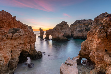Amazing landscape at sunrise. Beautiful beach near Lagos in Ponta da Piedade, Algarve region, Portugal. Seascape with Cliff rocks.