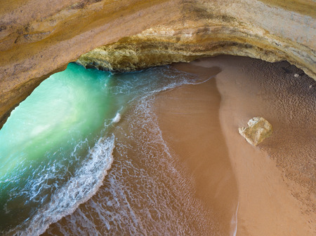 Famous natural cave at Benagil beach in Algarve Portugal.  landscape at one of the main holiday destinations in europe. Summer tourist attraction. Drone aerial view. Stock fotó