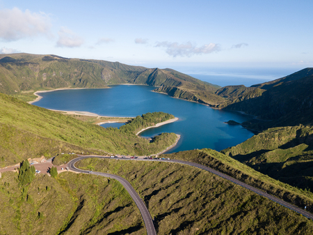 Aerial view of Lagoa do Fogo, a volcanic lake in Sao Miguel, Azores Islands. Portugal landscape taken by drone.  Amazing tourist attraction.