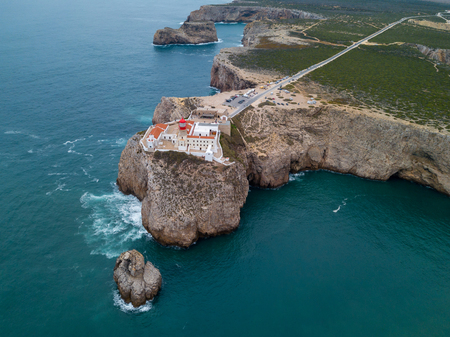 Aerial drone panoramic view of the lighthouse and cliffs at Cape St. Vincent at sunset. Algarve seascape.  Amazing landscape.Continental Europe's most South-western point, Sagres, Portugal. 版權商用圖片 - 122978609
