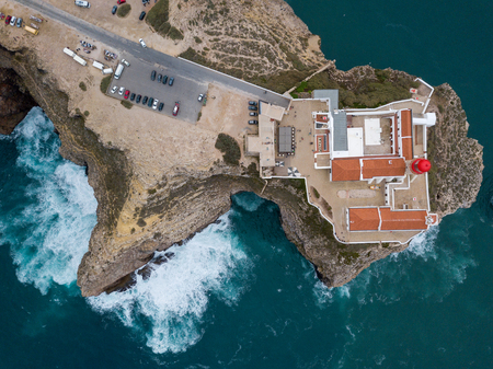 Aerial drone panoramic view of the lighthouse and cliffs at Cape St. Vincent at sunset. Algarve seascape.  Amazing landscape.Continental Europes most South-western point, Sagres, Portugal.