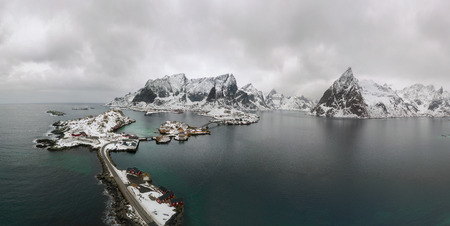 Aerial view of Lofoten. Drone panorama landscape of Reine and Hamnoy fishing villages with fjords and mountains in the background in Norway. Top view of Lofoten Islands winter scenery.