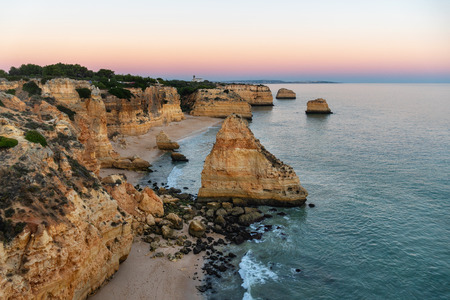 Amazing seascape at sunset at Marinha Beach in the Algarve, Portugal. Landscape with strong colors of one of the main holiday destinations in europe. Summer tourist attraction.