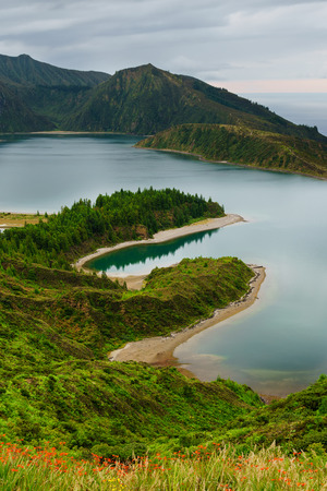 Panoramic view of natural landscape in the Azores, wonderful island of Portugal. Beautiful lagoons in volcanic craters and green fields. Tourist attraction and travel destination. Standard-Bild