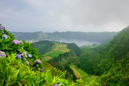 Azores panoramic view of natural landscape, wonderful scenic island of Portugal. Beautiful lagoons in volcanic craters and green fields. Tourist attraction and travel destination. Stock fotó