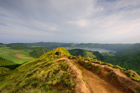 Azores panoramic view of natural landscape, wonderful scenic island of Portugal. Beautiful lagoons in volcanic craters and green fields. Tourist attraction and travel destination. 版權商用圖片