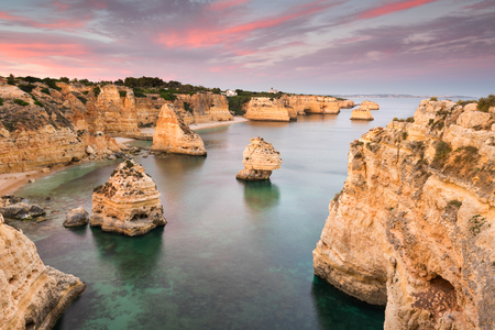 Amazing sunset at Marinha Beach in the Algarve, Portugal. Landscape with strong colors of one of the main holiday destinations in europe. Summer tourist attraction. Stock fotó