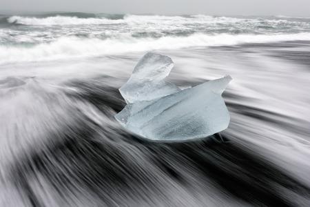 The amazing diamond beach in Iceland. Ice rock with black sand beach at Jokulsarlon beach. This famous sand lava beach is full of many giant ice gems, located near glacier lagoon Jokulsarlon