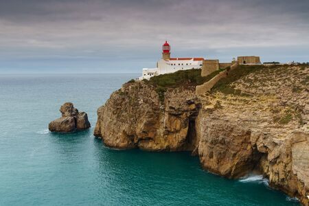 Landscape of the lighthouse and cliffs at Cape St. Vincent at sunset. Algarve amazing seascape.  Continental Europes most South-western point, Sagres, Portugal. 版權商用圖片