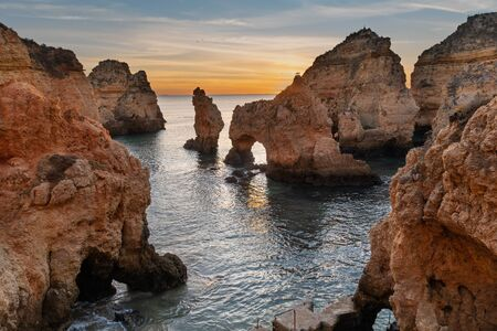 Amazing landscape at sunrise. Beautiful beach near Lagos in Ponta da Piedade, Algarve region, Portugal.  Seascape with Cciff rocks.