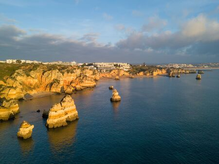 Algarve aerial drone panoramic view. Amazing landscape at sunrise. Beautiful beach near Lagos, Algarve region, Portugal.  Seascape with cliff rocks.