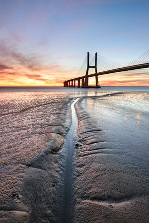 Vasco da Gama Bridge landscape at sunrise. One of the longest bridges in the world. Lisbon is an amazing tourist destination because its light, its monuments. Portugal landmark.