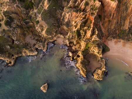 Algarve aerial drone panoramic view. Amazing landscape at sunrise. Beautiful beach near Lagos, Algarve region, Portugal.  Seascape with cliff rocks. 版權商用圖片 - 131603629