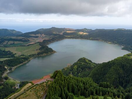 Aerial view of beautiful Furnas lagoon in the Azores islands. Drone landscape view with lines and textures in the background. Top view of volcanic crater, tourist attraction of Portugal. 版權商用圖片