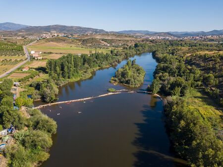 Aerial view over the amazing river. Drone point of view in summer landscape. Mirandela holiday destination for tourists looking for the countryside