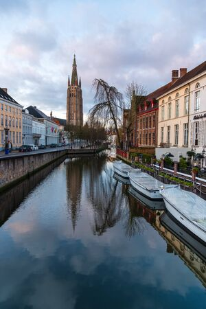 Bruges, Belgium iconic medieval houses, towers and Rozenhoedkaai canal. Classic postcard view of the historic city center. Often referred to as The Venice of the North. West Flanders province, Belgium.