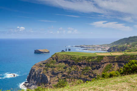 Azores, Portugal. Islet formed by an old volcanic crater. Travel destination in Europe, landscape with tropical vegetation. Wonderful beach in the Atlantic Ocean.