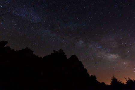 Dark night with a sky full of stars and the beautiful Milky Way. Night landscape wonder of nature.