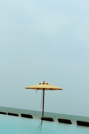 idling: Beach chairs with umbrella and beautiful beach