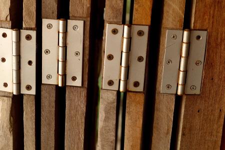 choppy: Old door hinge on wooden door.