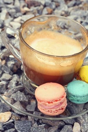 close p: Hot coffee and macaroon.