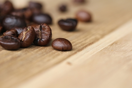coffeetree: Close up Coffee bean on grunge wooden background