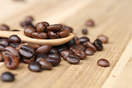 coffeetree: Coffee beans in wooden spoon, close up Stock Photo