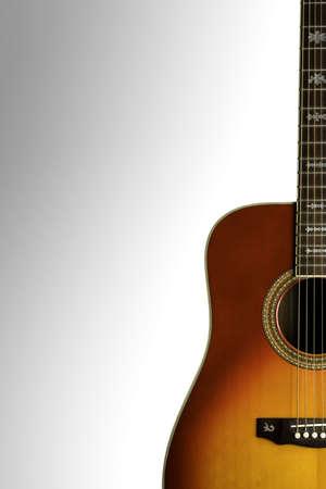 resonate: Acoustic Guitar. ReddishOrange acoustic guitar on a white background. Stock Photo