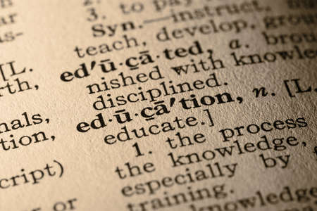 pronounce: The word education. Close-up of the word education in a dictionary.