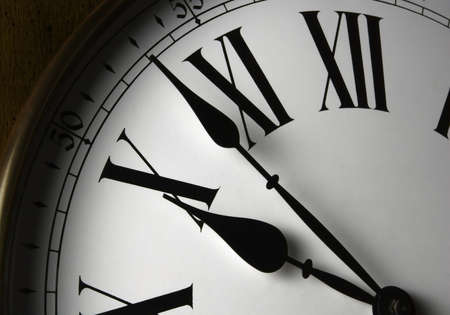 Wall Clock Face. Close-up of a white faced wooden wall clock with roman numerals. Stock Photo - 659242