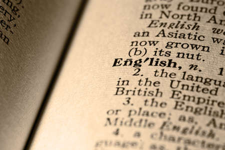 definition define: The word English. Close-up of the word English in a dictionary. Stock Photo