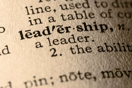 define: The word leadership. Close-up of the word leadership in a dictionary.