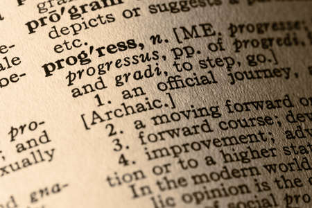 definition define: The word progress. Close-up of the word progress and its definition in a dictionary Stock Photo