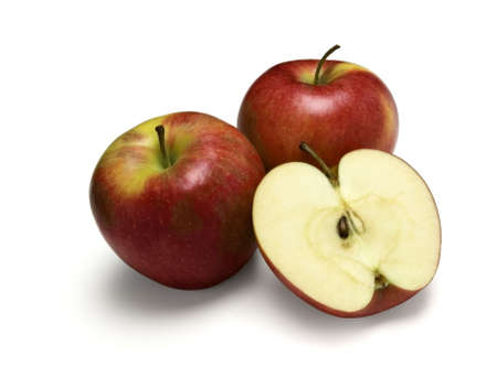 pinata: Healthy Snack. Pinata apples. Two whole and one cut in half. Isolated on a white background.