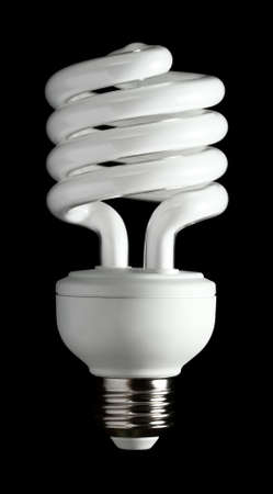 A more efficient bulb. Fluorescent light bulb isolated on a black background. photo